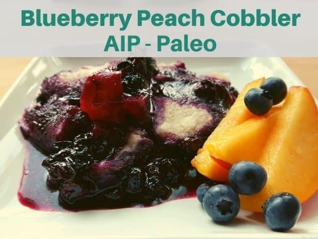 blueberry peach cobbler on white plate